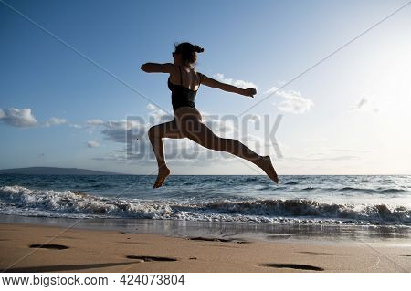 Woman Running Silhouette. Healthy Fitness Girl Jogging At Beach.