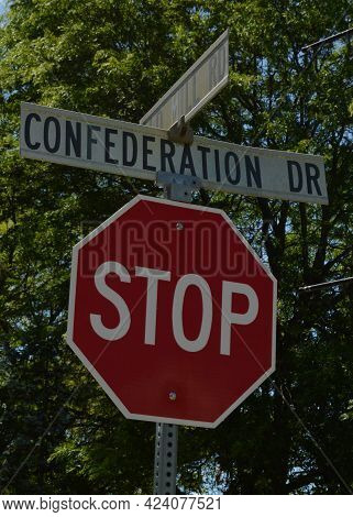 An Intersection Stop Sign Located At Old Mill Road And Confederation Drive In Smiths Falls, Ontario.