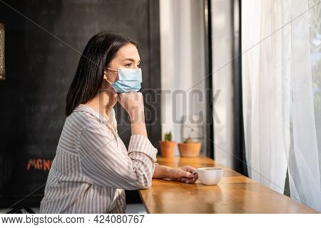 Caucasian Beautiful Woman Customer Wear Face Mask Due To Covid 19 Pandemic, Keep Distance Sit Alone