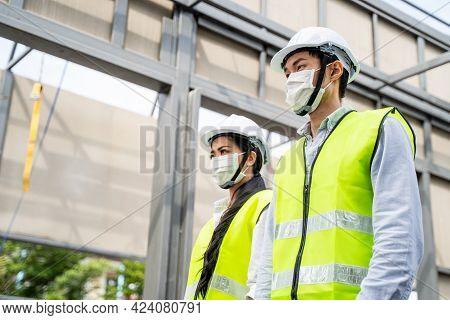 Asian Colleagues Workers People Wearing Protective Face Mask Onsite Of Architecture Due To Covid-19