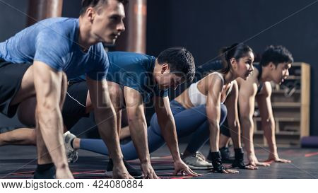 Group Of Active Multiethnic Fitness Trainer Workout To Maintain Muscle At Gym Or Stadium. Attractive