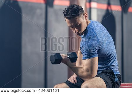 Caucasian Attractive Young Sportsman Trainer Workout, Exercise To Maintain Muscle In Stadium. Active