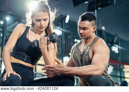 Asian Fitness Trainer Male Support And Motivate Young Beautiful Beginner Sportswoman Workout By Lift
