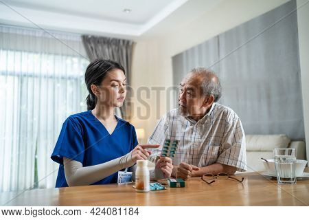 Asian Senior Elderly Male Patient Consult With Physician Nurse At Nursing Home Care. Caregiver Thera