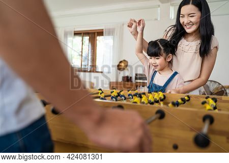 Asian Little Cute Kid Daughter Having Fun Spend Free Leisure Time With Parents In House. Young Presc