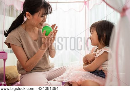 Asian Beautiful Loving Mother Teach Young Little Girl Daughter About Color In Tent At Home. Parent P