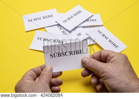 Some Tickets With The Word Subscribe Arranged On The Table, As A Concept Of The Choice To Subscribe