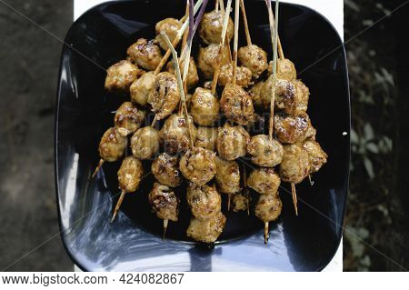 Cooking Barbecue Meatball Satay In Grilling Stove. This Is Indonesian Traditional Street Food Made F