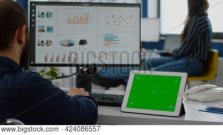 Paralyzed Invalid Handicapped Businessman Sitting In Wheelchair Analysing Financial Statistics, Look