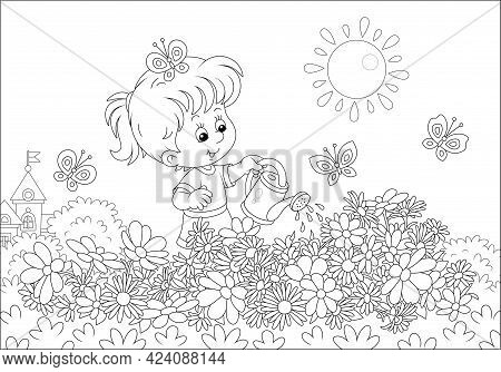 Happy Little Girl Watering Beautiful Garden Flowers On A Pretty Small Flowerbed On A Sunny Summer Da