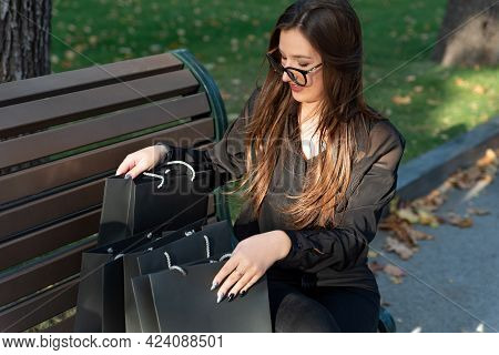Portrait Of Brunette Woman With Black Shopping Bags After Successful Shopping.