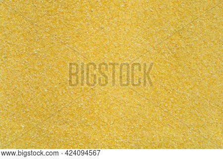 Detail Of A Surface Covered In Uncooked Polenta