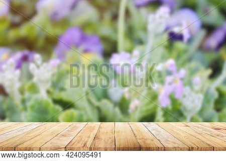 Shelf Of Brown Wood Plank Board With Blurred Wooden Wall Nature Background. Old Vintage Style.