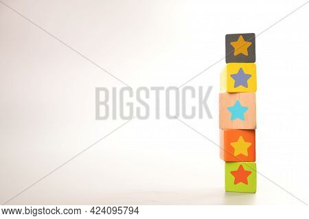 Wooden Block With Star Icons. Customer Evaluation And Satisfaction Concept.