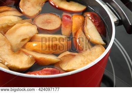 Pot Of Delicious Compot With Dried Apple Slices On Stove, Closeup