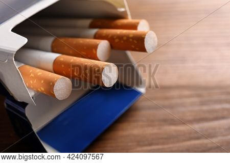 Pack Of Cigarettes On Wooden Table, Closeup