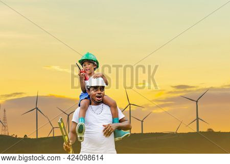 Cheerful African American Father And Son In Hard Hat, Happy Dad Carrying Son On Shoulders With Clipp