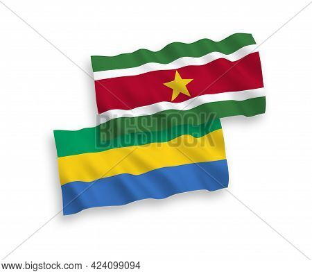 National Fabric Wave Flags Of Republic Of Suriname And Gabon Isolated On White Background. 1 To 2 Pr