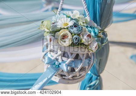 Setup Of Wedding Day Marriage Aisle With Drapes And Flower Bouquet On Sandy Tropical Beach Paradise