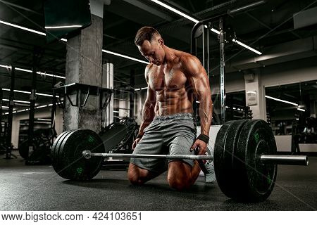 Injury Athlete With A Barbell Preparing For A Workout In The Gym For Sports, Fitness, Weightlifting,