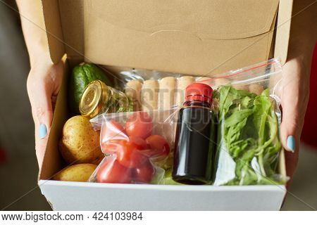 Woman Hold In Hand Food Box Meal Kit Of Fresh Ingredients Order From A Meal Kit Company