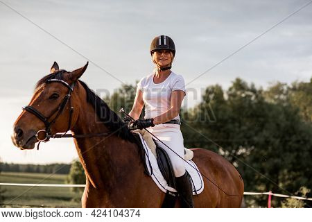 Portrait Of Young Laughing Woman On Horse. Concept Of Happiness And Enjoyment Of Wildlife. Sports An
