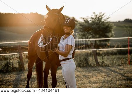 Beautiful Woman On Summer Evening Stands Next To Her Horse, They Are Happy Together .concept Of Heal