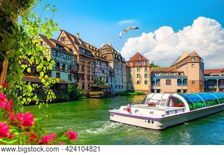 Excursion Boat In River By Buildings In Strasbourg