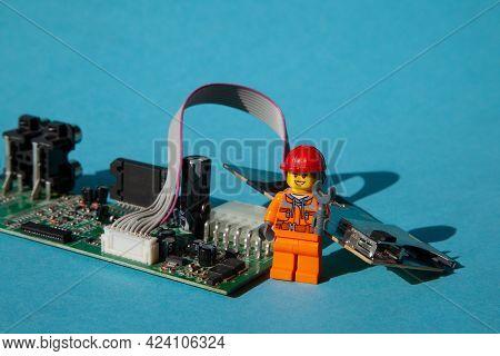 Ukraine, Kyiv - April 6, 2021: Computer Repair Lego Men. Workers And Engineers. Repairmen And Crafts