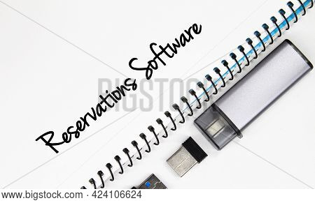 Pendrive, Usb And White Paper With The Word Reservations Software