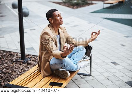 Relaxed Male Person Enjoying Process Of Meditation