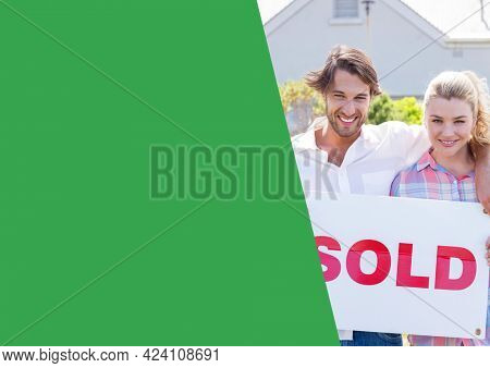 Composition of green copy space with smiling couple holding property sold sign. property, ownership and investment concept digitally generated image.