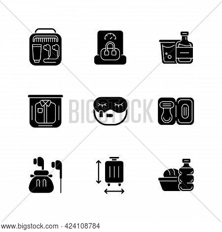 Essential Tourist Pack For Travel Black Glyph Icons Set On White Space. Packing Clothes And Compact