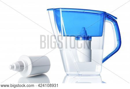 Water Filter Jug With A Replaceable Cartridge Isolated On White With Reflections