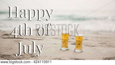 Composition of happy 4th of july text with two beers on beach. united states of america celebration, holiday, patriotism and independence concept digitally generated image.