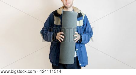 A Young Man Holding A Yoga Mat And Carry It To The Class, Copy Space, Sport And Fitness Concept