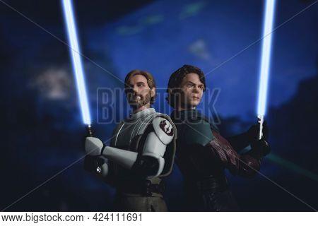 JUNE 17 2021:  Star Wars The Clone Wars Jedi Generals Anakin Skywalker and Obi Wan Kenobi with lightsabers drawn - Hasbro action figures