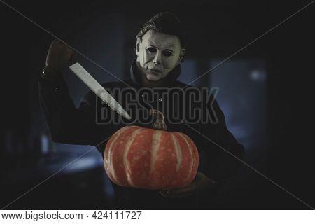 JUNE 17 2021: Halloween slasher Michael Myers carving a pumpkin - Trick or Treat Studios Action Figure