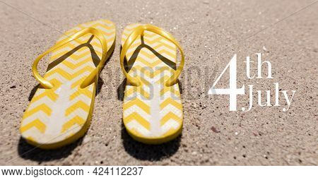 Composition of happy 4th of july text with flip flops on sand. united states of america celebration, holiday, patriotism and independence concept digitally generated image.