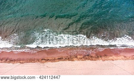 Beautiful Aerial Top Down Landscape To A Beach With Crashing Waves.
