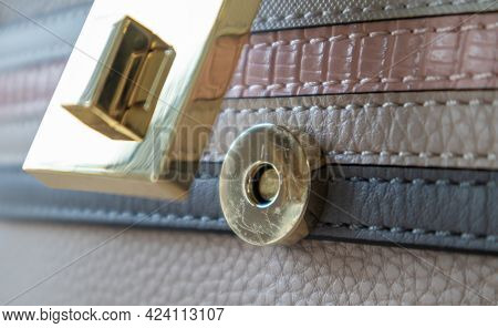 Close-up Of A Gold Magnetic Button-lock Of An Open Elegant Womens Fashionable Beige Leather Shoulder