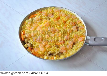Homemade Paella In A Pan With Chicken And Shrimps