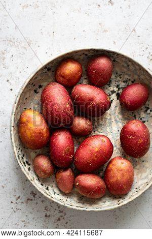 Raw ruby gem potatoes in a bowl