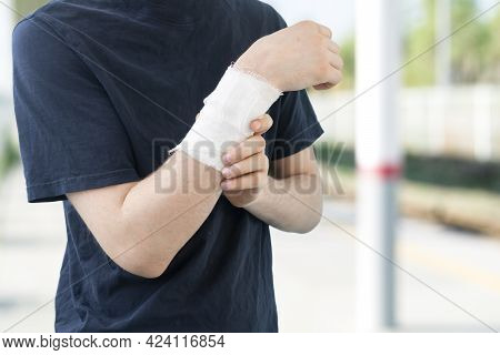 A Male Person With A White Bandage In The Arm, Medical Pain And Injury, Feeling Hurt