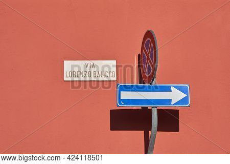 One Way Traffic Sign, Traffic Road Sign, Sign With Name Of The Street Reading - Via Lorenzo Balicco
