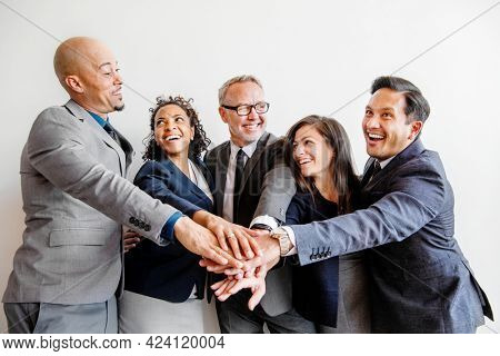 Businesspeople joining hands in the middle