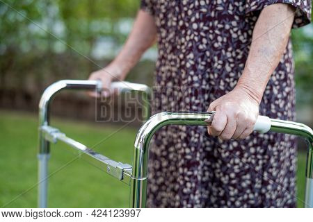 Asian Senior Or Elderly Old Lady Woman Patient Walk With Walker In Park,  Healthy Strong Medical Con