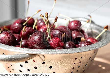 Washed Fresh Ripe Sweet Cherries With Water Drops On The Peel In Metalic Colander Bowl Summer Health