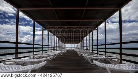 Chaise Lounges Under A Canopy,beautiful View On Sea