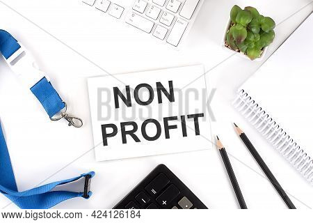 Non Profit Words On Card With Keyboard And Office Tools